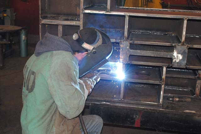 Man welding large table
