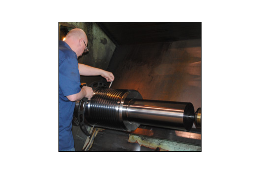 Man working with large metal machine